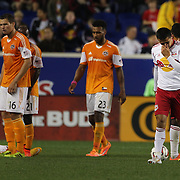 Tim Cahill, (right), New York Red Bulls, is sent off for a reckless challenge on Boniek García, Houston Dynamo, during the New York Red Bulls Vs Houston Dynamo, Major League Soccer regular season match at Red Bull Arena, Harrison, New Jersey. USA. 4th October 2014. Photo Tim Clayton