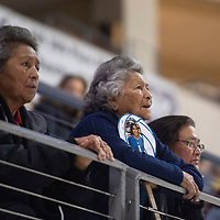 Left to right, Flo Sousea, Mae Ann Scott and Angela Riley,  fans of the Laguna Acoma Hawks watch their match against Dexter Friday morning at the Santa Ana Star Center in the NMAA Class 3A State Volleyball tournament in Rio Rancho. The Hawks beat Dexter in four sets.