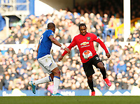 Football - 2019 / 2020 Premier League - Everton vs. Manchester United<br /> <br /> Odion Ighalo of Manchester United runs at Djibril Sidibe of Everton after coming on as substitute, at Goodison Park.<br /> <br /> COLORSPORT/ALAN MARTIN