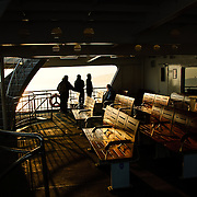 The setting sun shows on the deck of a passenger ferry on Istanbul's Bosphorus Strait.