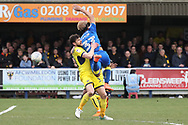 AFC Wimbledon defender Paul Kalambayi (30) man handling  AFC Wimbledon striker Lyle Taylor (33) during the EFL Sky Bet League 1 match between AFC Wimbledon and Oxford United at the Cherry Red Records Stadium, Kingston, England on 10 March 2018. Picture by Matthew Redman.