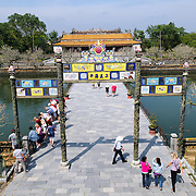 Elevated view of the bridge of the main entrance at the Imperial City in Hue, Vietnam. A self-enclosed and fortified palace, the complex includes the Purple Forbidden City, which was the inner sanctum of the imperial household, as well as temples, courtyards, gardens, and other buildings. Much of the Imperial City was damaged or destroyed during the Vietnam War. It is now designated as a UNESCO World Heritage site.