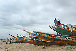 Sept. 27, 2013 - AB, Canada - Fisherman wait on boats at a fish market in M'bour or MBour, Senegal is shown on Friday September 27, 2013.  .M'Bour or Mbour is a city in the ThiÌÄå¬s Region of Senegal. It lies on the Petite CÌÄå«te, approximately 80 km south of Dakar. It is home to a population of 153,503 (2002 census). .The city's major industries are tourism, fishing and peanut processing. M'Bour is also the most important place of tourism in Senegal because it is situated on the little cost side. Jim Wells/Calgary Sun/QMI Agency (Credit Image: © Jim Wells/QMI Agency/ZUMAPRESS.com)