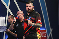 Michael Smith wins the match and celebrates during the World Darts Championships 2018 at Alexandra Palace, London, United Kingdom on 27 December 2018.