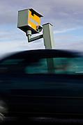 Traffic passes Gatso speed camera on A40, Oxfordshire, England, United Kingdom