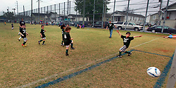 23 March 2013. New Orleans, Louisiana,  USA. .Carrolton Boosters Soccer. Under 8's. Champions. 'Owls' on their way to victory. Emerging as champions in a final 7-2 game against the 'Soldiers.' Lots of bruising games against many valiant opponents..Photo; Charlie Varley.
