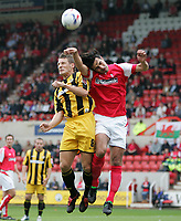 Photo: Lee Earle.<br /> Swindon Town v Port Vale. Coca Cola League 1. 08/10/2005. Swindon's Rory Fallon (R) and Michael Cummins battle for the ball in the air.