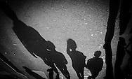 France. Paris. 4th district. Le Marais. Shadows of pedestrians in the streets