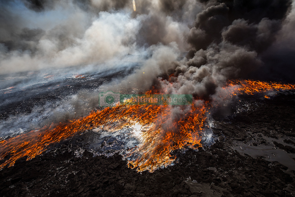 November 23, 2016 - Qayyara, Ninewa Province, IRAQ - Fires have been burning for the last four months in the oil rich town of Qayarra, south of Mosul ever since ISIS retreated and set fire to the wells, creating a massive environmental disaster. These massive fires are now visible from space. (Credit Image: © Gabriel Romero via ZUMA Wire)