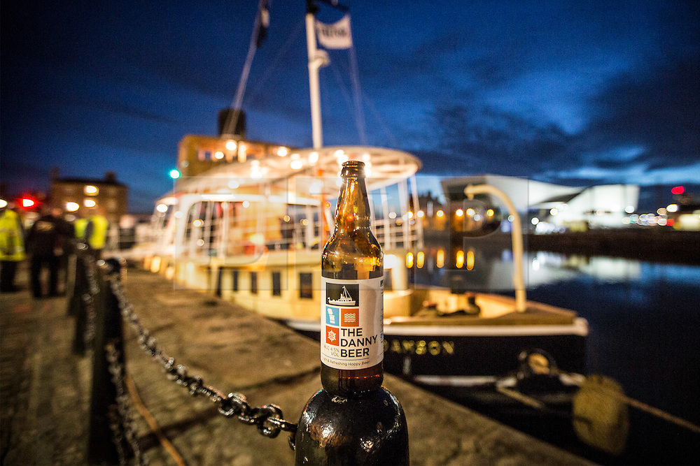 """© Licensed to London News Pictures. 04/05/2016. Birkenhead UK. Picture shows the Daniel Adamson beer brewed to celebrate the renovation of the Daniel Adamson by Titanic brewery. The Daniel Adamson steam boat has been bought back to operational service after a £5M restoration. The coal fired steam tug is the last surviving steam powered tug built on the Mersey and is believed to be the oldest operational Mersey built ship in the world. The """"Danny"""" (originally named the Ralph Brocklebank) was built at Camel Laird ship yard in Birkenhead & launched in 1903. She worked the canal's & carried passengers across the Mersey & during WW1 had a stint working for the Royal Navy in Liverpool. The """"Danny"""" was refitted in the 30's in an art deco style. Withdrawn from service in 1984 by 2014 she was due for scrapping until Mersey tug skipper Dan Cross bought her for £1 and the campaign to save her was underway. Photo credit: Andrew McCaren/LNP ** More information available here http://tinyurl.com/jsucxaq **"""