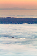 A Freighter shows through the fog in Vancouver's English Bay with Point Grey in the distance.  Photographed from the Cypress Lookout in Cypress Provincial Park in West Vancouver, British Columbia, Canada.