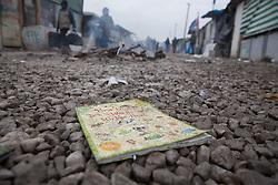 """Dschungel von Calais: Das wilde Fl¸chtlingslager wird ger‰umt und die Fl¸chtlinge in Aufnahmezentren verteilt / 241016 ***Calais, Pas-de-Calais, France - 24.10.2016    <br />  <br /> """"First english world""""-book in the mud of Clais.  Start of the eviction on the so called îJungle"""" refugee camp on the outskirts of the French city of Calais. Refugees and migrants leaving the camp to get with buses to asylum facilities in the entire country. Many thousands of migrants and refugees are waiting in some cases for years in the port city in the hope of being able to cross the English Channel to Britain. French authorities announced a week ago that they will evict the camp where currently up to up to 10,000 people live.<br /> <br /> """"First english words""""-Buch liegt im Schlamm von Calais. Beginn der Raeumung des so genannte îJungleî-Fluechtlingscamp in der franzˆsischen Hafenstadt Calais. Fluechtlinge und Migranten verlassen das Camp um mit Bussen zu unterschiedlichen Asyleinrichtungen gebracht zu werden. Viele tausend Migranten und Fluechtlinge harren teilweise seit Jahren in der Hafenstadt aus in der Hoffnung den Aermelkanal nach Groflbritannien ueberqueren zu koennen. Die franzoesischen Behoerden kuendigten vor einigen Wochen an, dass sie das Camp, indem derzeit bis zu bis zu 10.000 Menschen leben raeumen werden. <br /> <br /> Photo: Bjoern Kietzmann"""