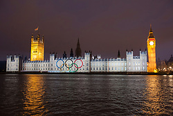 © licensed to London News Pictures. London, UK 27/07/2012. The Olympic Rings being projected on the Houses of the Parliaments during the Olympics opening ceremony on 27/07/12. Photo credit: Tolga Akmen/LNP