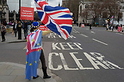 A day after Commons Speaker John Bercow announced his refusal to accept Prime Minster Theresa Mays third Brexit Meaningful Vote, a Remainer protests outside the gates of parliament, on 19th March 2019, in London, England.