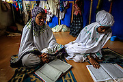 BAYEUN, ACEH, INDONESIA - JULY 11 : <br /> Woman of Rohingya migrant praying at temporary shelter camp in Bayeun, East Aceh, Indonesia on July 11. 2015. The boatpeople in Aceh are among thousands of Rohingya and Bangladeshi migrants who arrived in countries across Southeast Asia in May after a Thai crackdown threw the people-smuggling trade into chaos.<br /> ©Nira Cahaya/Exclusivepix Media