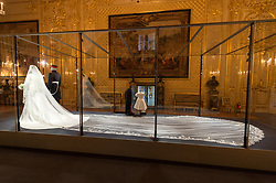© Licensed to London News Pictures. 25/10/2018. Windsor, UK. The Duchess of Sussex's wedding dress which was created by the British designer Clare Waight Keller Artistic Director at the historic French fashion house Givenchy. The Duke of Sussex uniform is from the Household Cavalry(the Blues and Royals. The outfits are on display at The Royal Collection at Windsor Castle. PLEASE NOTE, THIS PHOTO IS EMBARGOED FOR PUBLICATION UNTIL 00:01 FRIDAY 26 OCTOBER 2018. Photo credit: Ray Tang/LNP