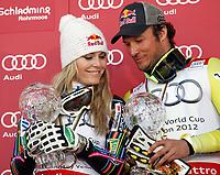 ALPINE SKIING - WORLD CUP 2011/2012 - SCHLADMING (AUT) - FINAL -  15/03/2012 - PHOTO : ARMANDO TROVATI / PENTAPHOTO / DPPI - PODIUM SUPER G - Aksel lund Svindal (NOR) and LINDSEY VONN (USA) CRISTAL GLOBE