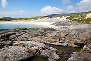 Rocky headland and sandy beach at Bagh a Deas, South Bay, Vatersay island,Barra, Outer Hebrides, Scotland, UK