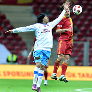 Galatasaray's Ayhan AKMAN (R) and Trabzonspor's Gustavo COLMAN (L) during their Turkish superleague soccer derby match Galatasaray between Trabzonspor at the TT Arena in Istanbul Turkey on Sunday, 10 April 2011. Photo by TURKPIX