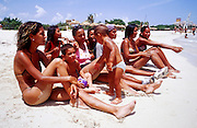23 JULY 2002 - TRINIDAD, SANCTI SPIRITUS, CUBA: Cuban family at Playa Ancon beach near the colonial city of Trinidad, province of Sancti Spiritus, Cuba, July 23, 2002. Trinidad is one of the oldest cities in Cuba and was founded in 1514..PHOTO BY JACK KURTZ
