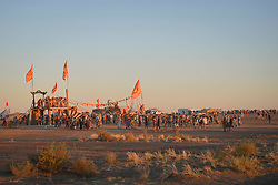 Apr 30, 2016 - Tankwa Town, Karoo Desert, South Africa - Participants of this year's AfrikaBurn watch the event's last sunset over the Karoo Desert in South Africa on April 30, 2016. AfrikaBurn, the smaller cousin of Burning Man, is now in its tenth year and aims to bring together creatives from all around the world to create art, exist in a non-monetary economy, and celebrate an alternative form of living. (Credit Image: © Tobin Jones/ZUMA Wire/ZUMAPRESS.com)