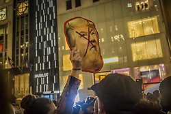 November 10, 2016 - New York, NY, United States - Thousands of Anti-Trump Protesters Hit the Streets in NYC Chanting ''Not My President.''..Various protests gathered around Manhattan and eventually took the streets, wending their way to Trump Tower chanting, among other things, ''Not My President'' and ''Fuck Donald Trump.'' Groups including Black Lives Matter, Socialist Alternative and Pussy Grabs Back converged with thousands of disgruntled citizens in the streets. Despite a NYPD escort, who threatened arrest throughout the march, the protestors blocked traffic, marched into a few business and defined police orders to return to the sidewalk. All the marches converged near 42nd Street and Broadway and then, after making their way to 5th Avenue, packed themselves before Trump Tower.  Hundreds of police lined the street and set barricades. a dozens monstrous sanitation vehicles also line the street, blocking any access to the the building....Various protests gathered around Manhattan and eventually took the streets, wending their way to Trump Tower chanting, among other things, ''Not My President'' and ''Fuck Donald Trump.'' Groups including Black Lives Matter, Socialist Alternative and Pussy Grabs Back converged with thousands of disgruntled citizens in the streets. Despite a NYPD escort, who threatened arrest throughout the march, the protestors blocked traffic, marched into a few business and defined police orders to return to the sidewalk. All the marches converged near 42nd Street and Broadway and then, after making their way to 5th Avenue, packed themselves before Trump Tower.  Hundreds of police lined the street and set barricades. a dozens monstrous sanitation vehicles also line the street, blocking any access to the the building. (Credit Image: © Michael Nigro/Pacific Press via ZUMA Wire)