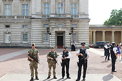 """Soldiers join police officers outside Buckingham Palace, London, as armed troops have been deployed to guard """"key locations"""" under Operation Temperer, which is being enacted after security experts warned the Government that another terrorist attack could be imminent."""