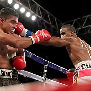 John Correa, right, punches Alejandro Barbosa during a Telemundo boxing match at Osceola Heritage Park on Friday, July 20, 2018 in Kissimmee, Florida.  (Alex Menendez via AP)
