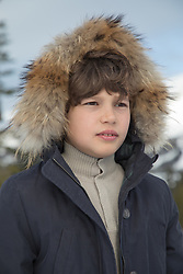 Boy in a fur lined parka coat