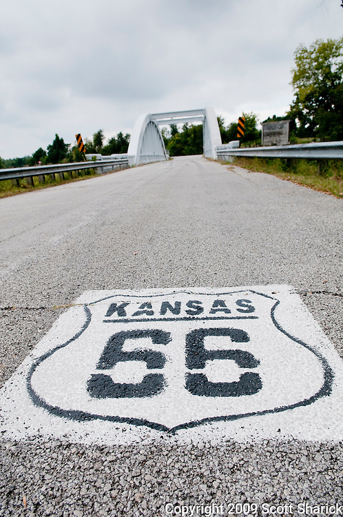 A Kansas Route 66 sign painted on the pavement. Missoula Photographer