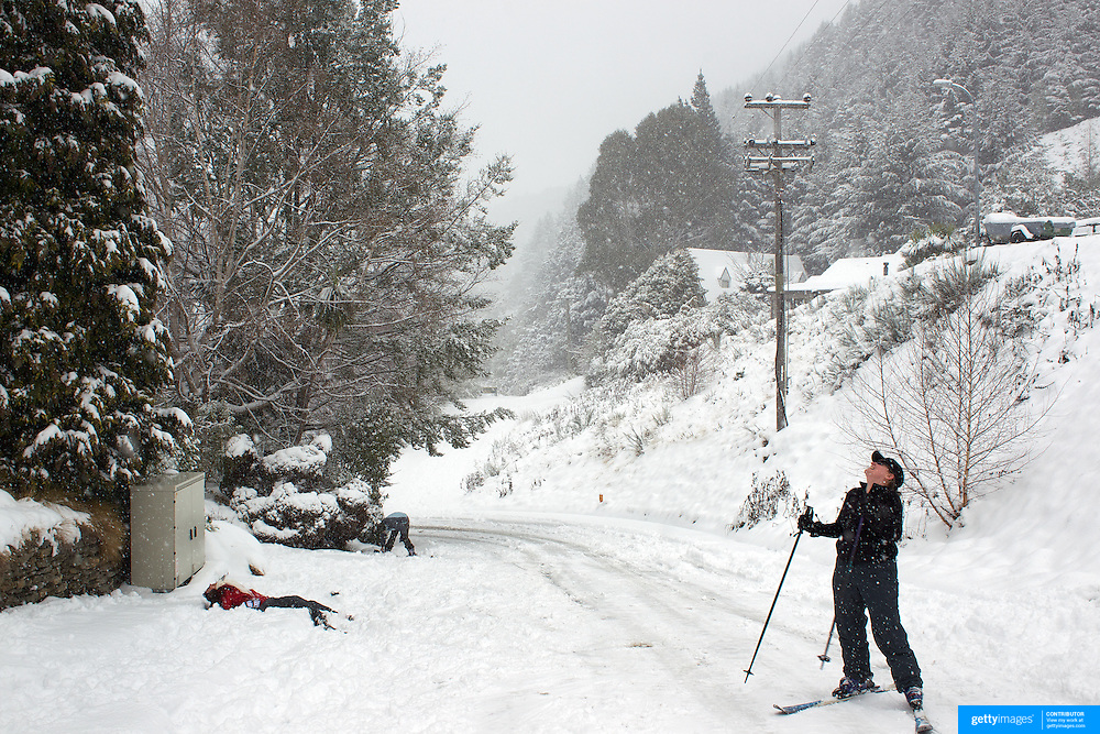 Nadia Lazari (left) falls while skiing in Arawata Terrace, Fernhill, Queenstown, as her friend Ness Holden reacts with laughter after the biggest snow storm in New Zealand in the past 50 years. Queenstown, New Zealand, 15th August 2011. Photo Tim Clayton
