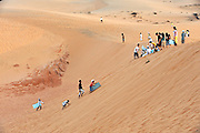 Climbing back up the dune after sliding down. Red Sand Dunes, Mui Ne, Vietnam