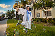 South Dade Senior High School graduate Chau Van, 17, stands in front of her apartment building in Homestead on Tuesday, May 12, 2020