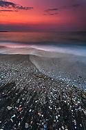 Summer dawn by the sea coast