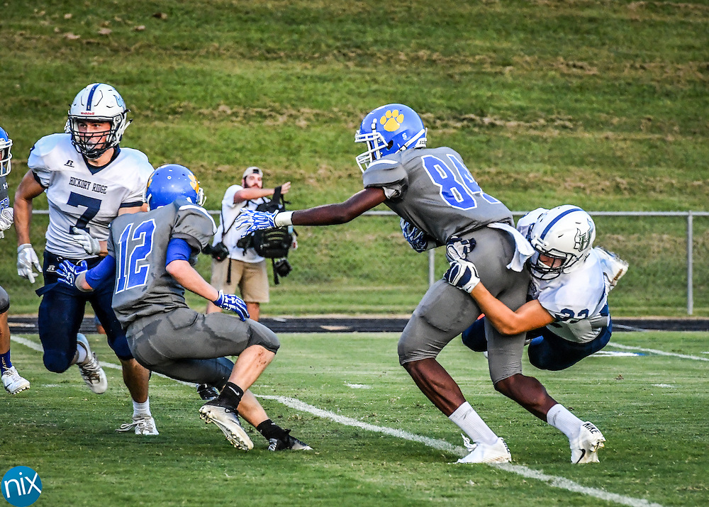 The Tigers, #84, Jacorey Alston, not going anywhere against a tough Hickory Ridge defense.