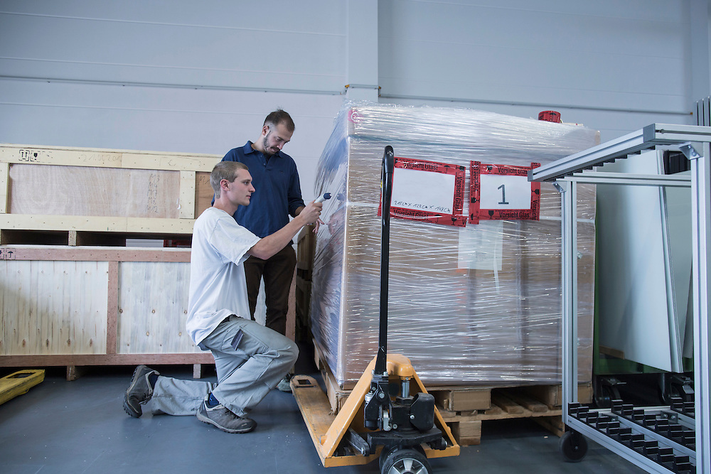 Store workers packaging in a distribution warehouse, Freiburg im Breisgau, Baden-Wuerttemberg, Germany