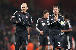 19-02-2013 VOETBAL: CHAMPIONS LEAGUE FC ARSENAL - FC BAYERN MUNCHEN: LONDEN<br /> Arjen ROBBEN (FC Bayern Muenchen - 10) unzufrieden, sauer - Philipp LAHM (FC Bayern Muenchen - 21) bedankt sich bei den Fans during the UEFA Champions League last sixteen first leg match between Arsenal FC and FC Bayern Munich at the Emirates Stadium<br /> ***NETHERLANDS ONLY***<br /> ©2012-FotoHoogendoorn.nl