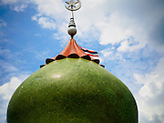 19 JUNE 2015 - PATTANI, PATTANI, THAILAND:  A minaret of Pattani Central Mosque. Pattani Central Mosque is the main mosque in Pattani and was built in 1963. It is especially crowded during Ramadan, when the crowd frequently spills out into the street.     PHOTO BY JACK KURTZ
