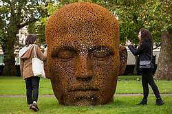 "© Licensed to London News Pictures. 01/10/2020. LONDON, UK. Women view ""Meditation 1554"", 2019, by contemporary Korean artist Seo Young-Deok, on display in Grosvenor Square as part of the inaugural Mayfair Sculpture Trail which will be on show for the month of October.  The sculpture trail forms part of the seventh, annual edition of Mayfair Art Weekend which celebrates the rich cultural heritage of Mayfair as one of the most internationally known, thriving art hubs in the world with free exhibitions, tours, talks and site-specific installations available to the public.  Photo credit: Stephen Chung/LNP"