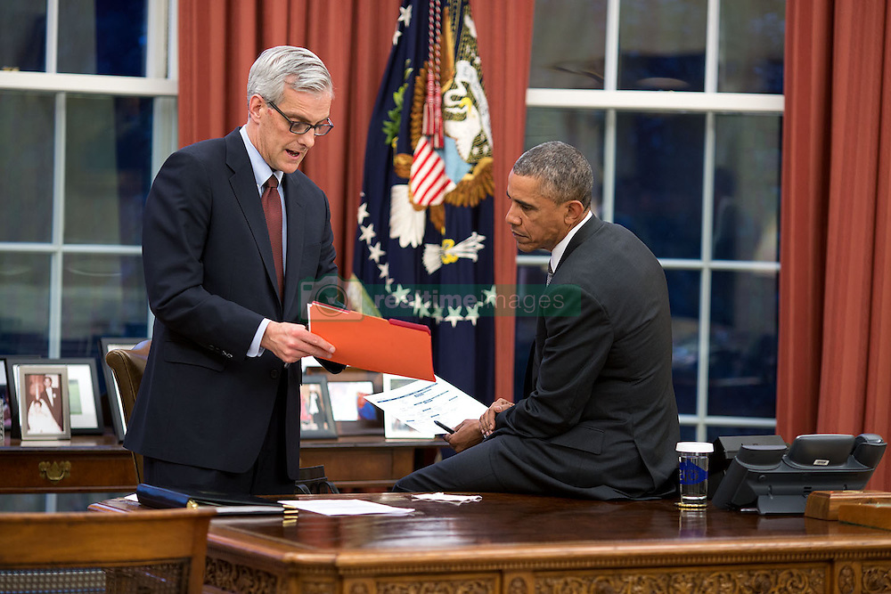 President Barack Obama confers with Chief of Staff Denis McDonough in the Oval Office, March 31, 2015. (Official White House Photo by Pete Souza)<br /> <br /> This official White House photograph is being made available only for publication by news organizations and/or for personal use printing by the subject(s) of the photograph. The photograph may not be manipulated in any way and may not be used in commercial or political materials, advertisements, emails, products, promotions that in any way suggests approval or endorsement of the President, the First Family, or the White House.