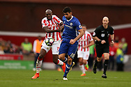 Diego Costa of Chelsea breaks away from a tackle from Bruno Martins Indi of Stoke city (l).  Premier league match, Stoke City v Chelsea at the Bet365 Stadium in Stoke on Trent, Staffs on Saturday 18th March 2017.<br /> pic by Andrew Orchard, Andrew Orchard sports photography.