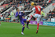 Rotherham United midfielder Danny Ward heads ball away from Johann Guomundsson of Charlton Athletic during the Sky Bet Championship match between Rotherham United and Charlton Athletic at the New York Stadium, Rotherham, England on 30 January 2016. Photo by Ian Lyall.