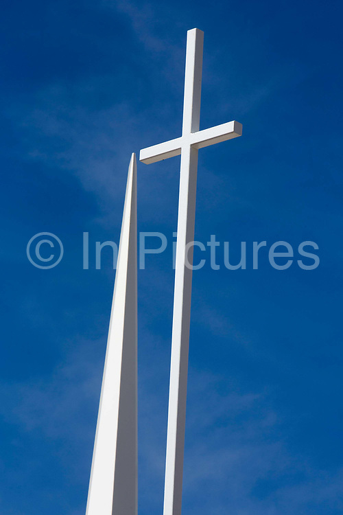 The white cross and spire of the Evangelical Free Church overlooking the high desert town of Yucca Valley in southern California.