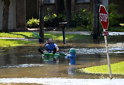 Sept. 1, 2017 - Houston, Texas, U.S. - A man paddles on a flooded street near Barker Reservoir, west of Houston. Heavy rain that fell following Hurricane Harvey inundated the Barker and Addicks reservoir areas, west of Houston.  Houston residents have begun to assess the storm's trail of destruction as Harvey's floodwaters slowly start to recede.(Credit Image: © Yin Bogu/Xinhua via ZUMA Wire)