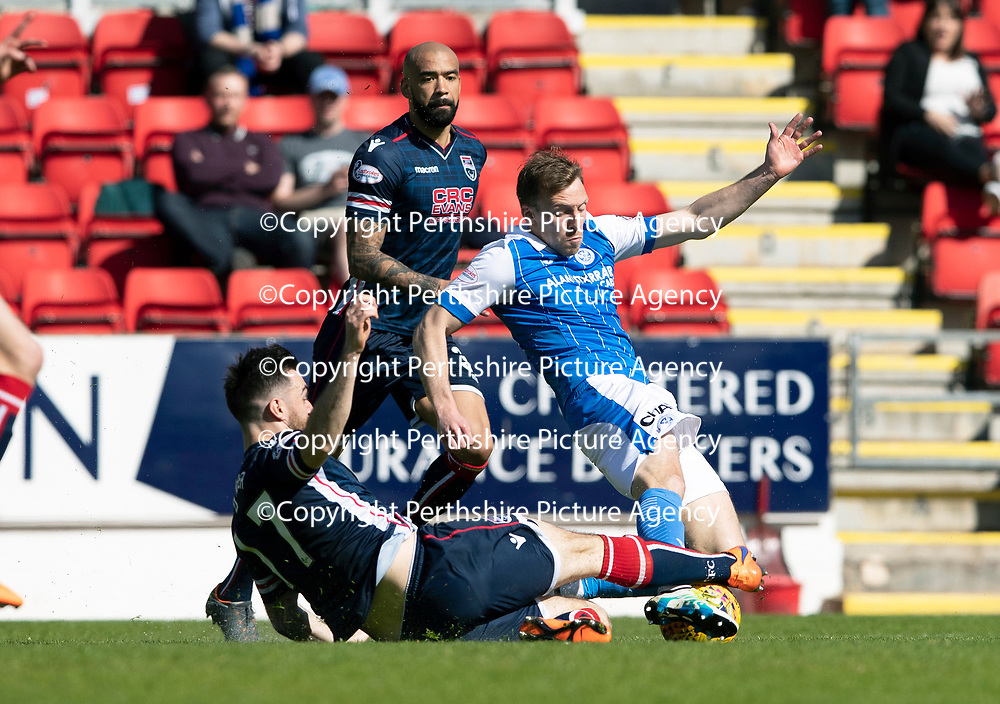 St Johnstone v Ross County…12.05.18…  McDiarmid Park    SPFL<br />David McMillan is tackled by Ross Draper<br />Picture by Graeme Hart. <br />Copyright Perthshire Picture Agency<br />Tel: 01738 623350  Mobile: 07990 594431