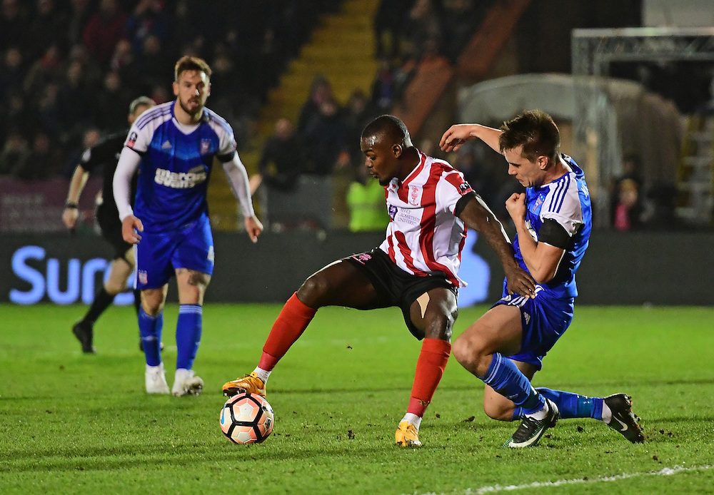 Lincoln City's Theo Robinson shields the ball from Ipswich Town's Jonas Knudsen<br /> <br /> Photographer Chris Vaughan/CameraSport<br /> <br /> Emirates FA Cup Third Round Replay - Lincoln City v Ipswich Town - Tuesday 17th January 2017 - Sincil Bank - Lincoln<br />  <br /> World Copyright © 2017 CameraSport. All rights reserved. 43 Linden Ave. Countesthorpe. Leicester. England. LE8 5PG - Tel: +44 (0) 116 277 4147 - admin@camerasport.com - www.camerasport.com
