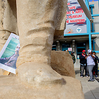 A poster of Dr. Martin Luther King Jr. tucks between the feet of the Chief Manuelito statue at the Gallup Cultural Center in Gallup Monday.