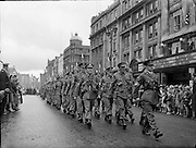 Troops from the 32nd Irish Battalion parade through Dublin to Baldonnel Aerodrome for an airlift to the Congo..27.07.1960