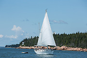 Mount Dessert Island, ME - 9 August 2014. Ketch Dream On, of Friendship, Maine, passing Bass Harbor Head Light.