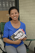 Huntington, New York, U.S. - August 6, 2014 - NEELIMA PRADHAN, of Huntington, is waiting on line to attend the book signing for H. Clinton's new memoir, Hard Choices, at the Book Revue in Huntington, Long Island. Clinton's book is about her four years as America's 67th Secretary of State and how they influence her view of the future.